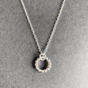 Silver beaded circle pendant