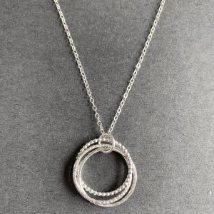 Three interlocking silver rings pendant
