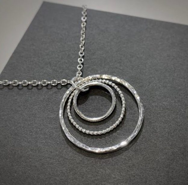 Three textured circles silver pendant