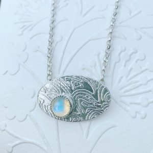 Moonstone and patterned silver necklace