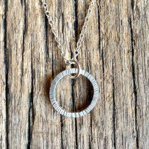 Bark texture silver circle pendant